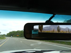 A view from the rear view mirror of leaving Arizona.